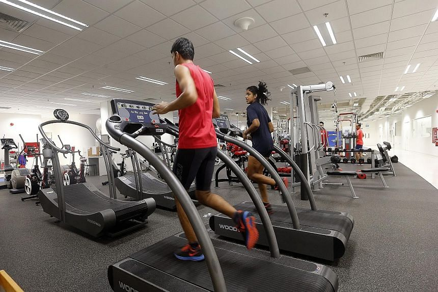 Para-athletes running on the treadmill to keep their endurance up as they switch to indoor training to avoid the haze.