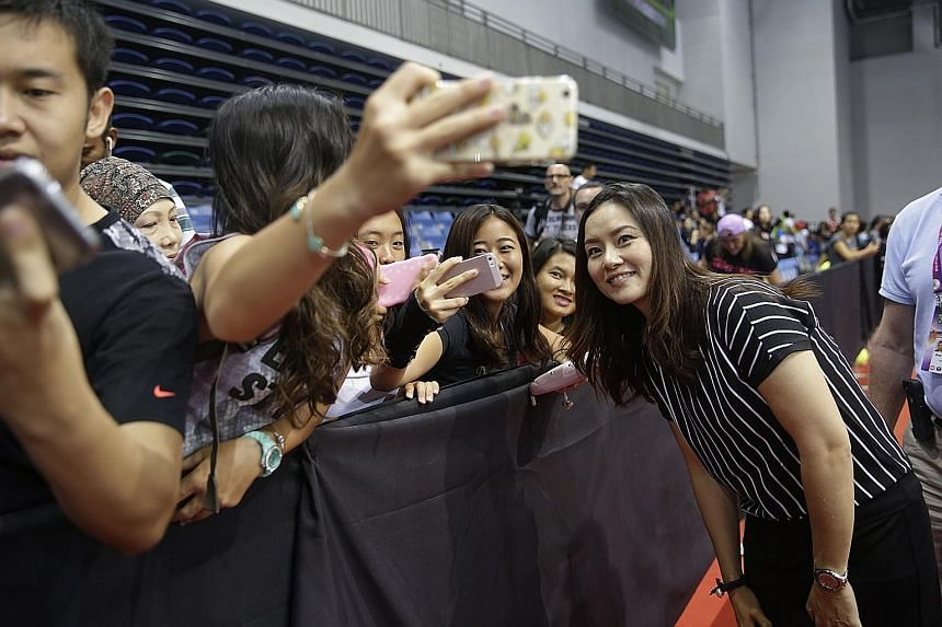 Retired Chinese tennis star Li Na, still a favourite off court, taking selfies with fans at the OCBC Arena before a WTA Rising Stars match.