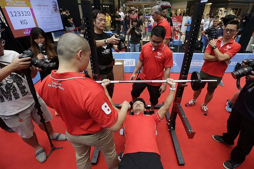 Parliamentary Secretary (Culture, Community and Youth) Baey Yam Keng trying his hand at powerlifting yesterday.
