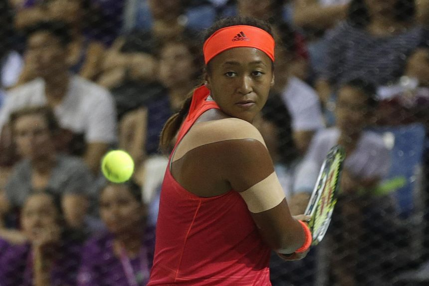 Japan's Naomi Osaka in action yesterday at the OCBC Arena where she beat China's Zhu Lin 4-2, 2-4, 5-4 to earn a place in the final of the WTA Rising Stars Invitational. The final, held at the Singapore Indoor Stadium today, will pit the 17-year-old