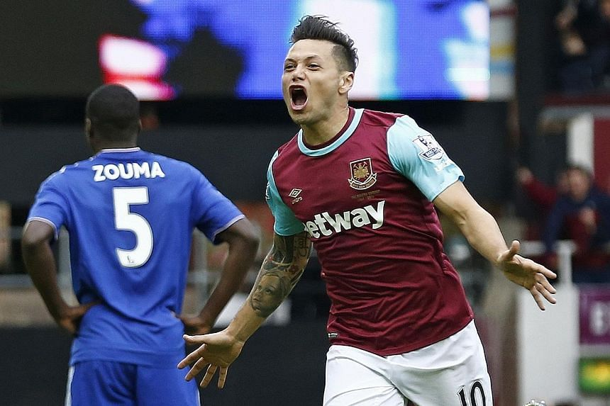 Mauro Zarate celebrating his scoring West Ham United's first goal at Upton Park after 17 minutes.