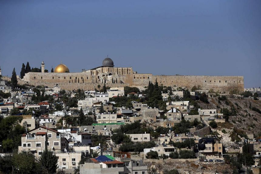 The Dome of the Rock mosque (golden dome) and Al-Aqsa mosque (silver dome) at the Al-Aqsa mosque compound in Jerusalem's Old City.