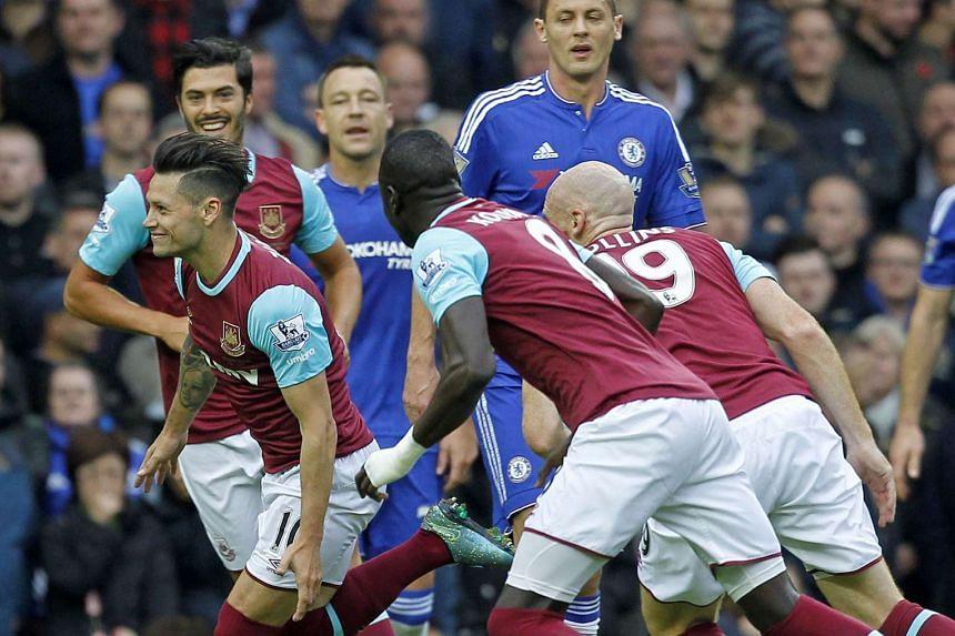 West Ham striker Mauro Zarate (front left) celebrates after scoring his team's first goal.