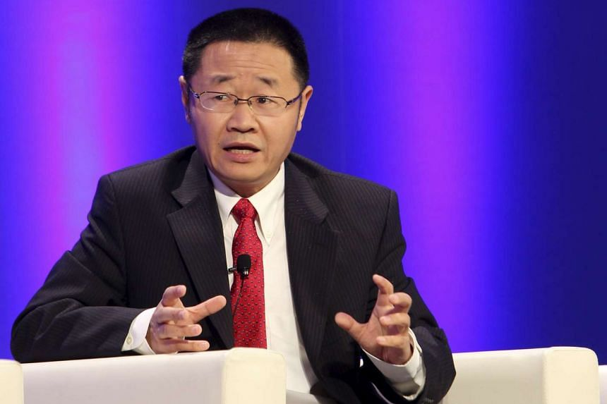Zhang Yujun, then President of Shanghai Stock Exchange, speaks at a conference in Shanghai, on Nov 24, 2011.