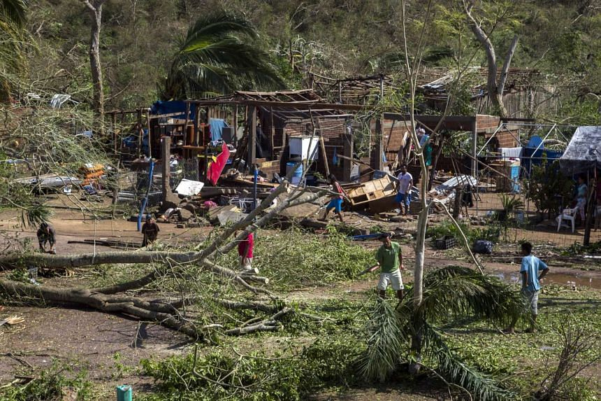 Residents of the Chamela community return to their homes after the passage of Hurricane Patricia in the southern coast of the state of Jalisco, Mexico.
