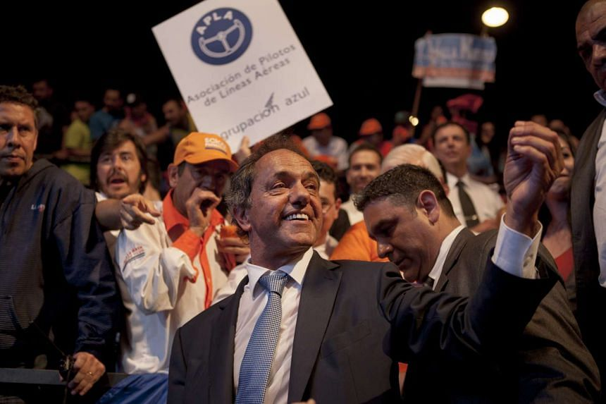 Daniel Scioli, Argentine presidential candidate, greets supporters after delivering a speech during a final campaign rally before the election at Luna Park in Buenos Aires, Argentina, on Oct 22, 2015.