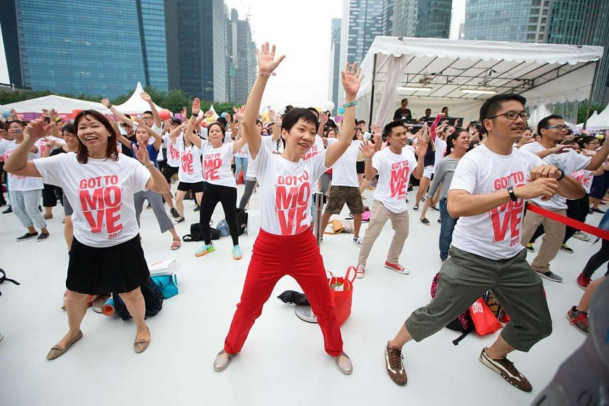 MCCY Minister Grace Fu (centre) getting into the groove at a mass dance held during the Got To Move carnival on Oct 24, 2015.