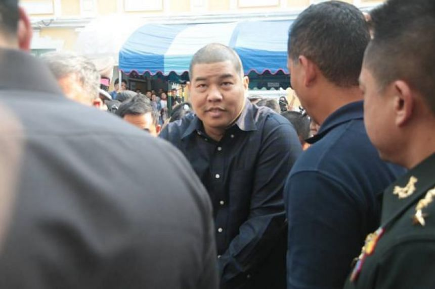 Pol Major Prakrom Warunprapa photographed on Oct 21, when he was taken to the military court.