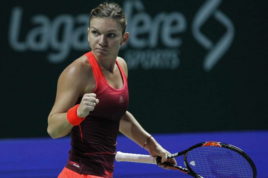 Simona Halep of Romania celebrates after winning her first set against Italian Flavia Pennetta at the BNP Paribas WTA Finals Singapore on Oct 25, 2015.