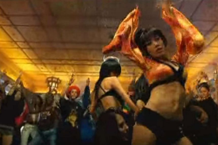 Ms Ho displaying her dare-to-bare attitude in her China Wine video (above) in 2007 that attracted much attention.
