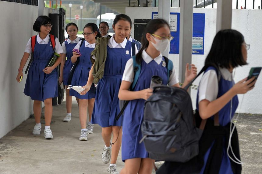 Primary 6 pupils at CHIJ leaving the school compound after their PSLE exams earlier this month. Questions are being asked as to whether it is appropriate for children to take a high-stakes examination at age 12, and whether the PSLE should be done away wi