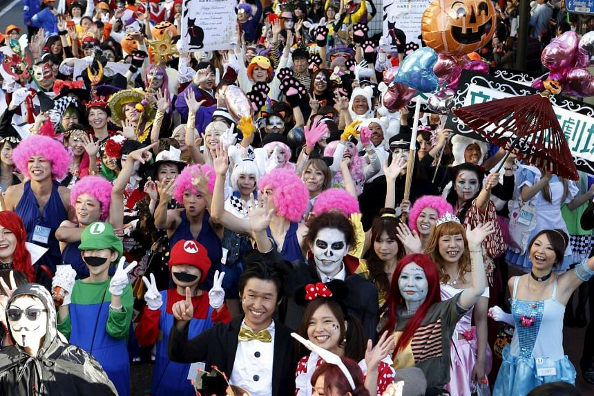 Participants in costume pose for a picture during a Halloween parade in Kawasaki, south of Tokyo, on Oct 25, 2015.