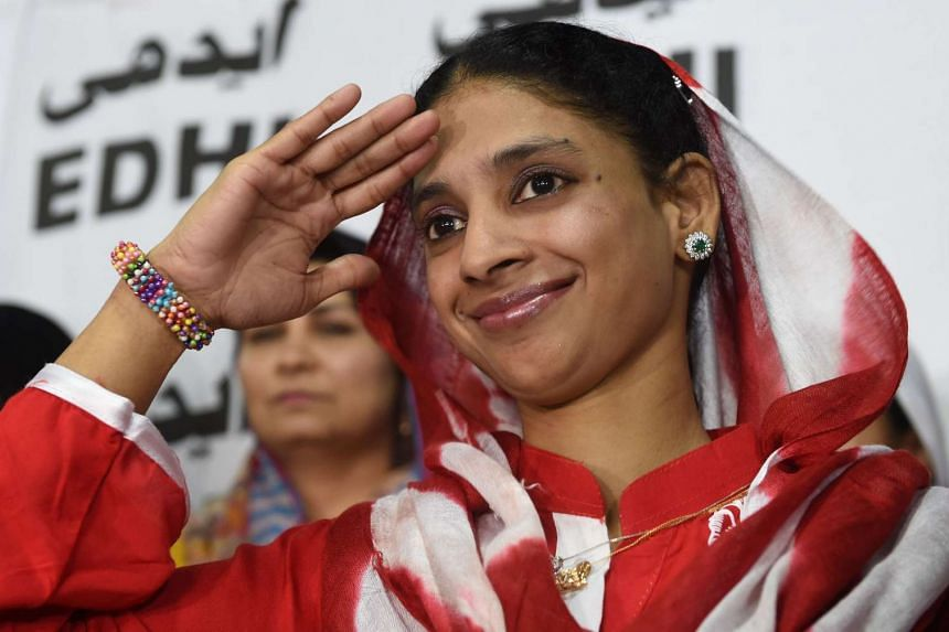 Geeta salutes the media before leaving for the airport from the EDHI Foundation in Karachi on Oct 26, 2015.