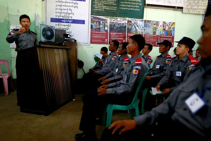Special police officers, who have been temporarily recruited for the upcoming general elections, attend a training session in Botahtaung police station at Yangon on Oct 26, 2015.