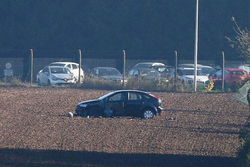 A damaged car sits outside the army barracks in Flawinne, Namur Province, in Belgium, after a man attempted to drive through the barrack's barriers on Oct 26, 2015.