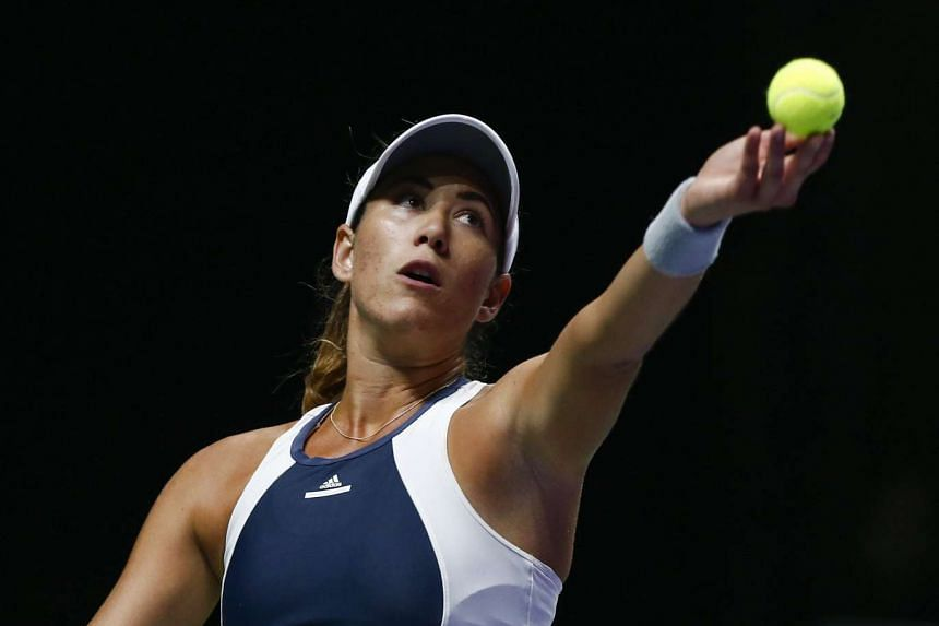 Garbine Muguruza of Spain prepares to serve the ball to Lucie Safarova of the Czech Republic during their BNP Paribas WTA Finals 2015 match at the Singapore Indoor Stadium on Oct 26, 2015.