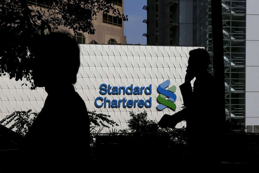 People walk past the main branch of Standard Chartered in Hong Kong.