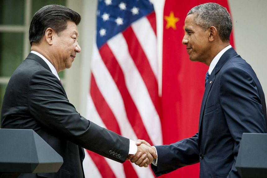 Chinese president Xi Jinping (left), shakes hands with US President Barack Obama following a joint news conference in the Rose Garden at the White House on Sept 25, 2015.