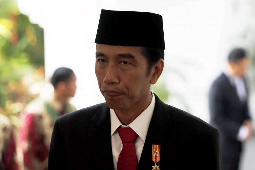 Indonesian President Joko Widodo is pictured after seeing off Danish Queen Margarethe at the presidential palace in Jakarta on Oct 22, 2015.
