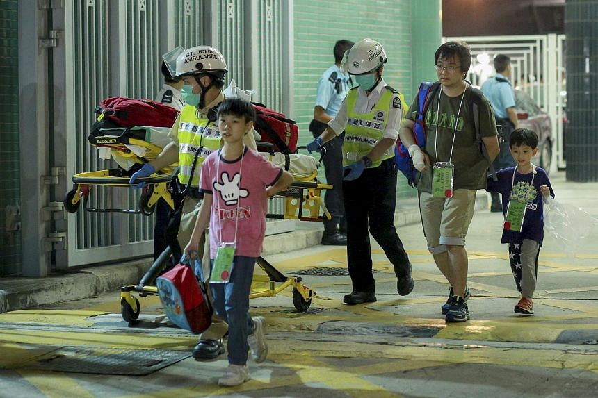 Ferry passengers walk with rescuers after getting onshore in Hong Kong, China on Oct 25, 2015.