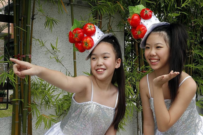 Ang Mo Kio Sisters Esther Ng (left) and Charlize Oie performed on the getai circuit for the first time this year.