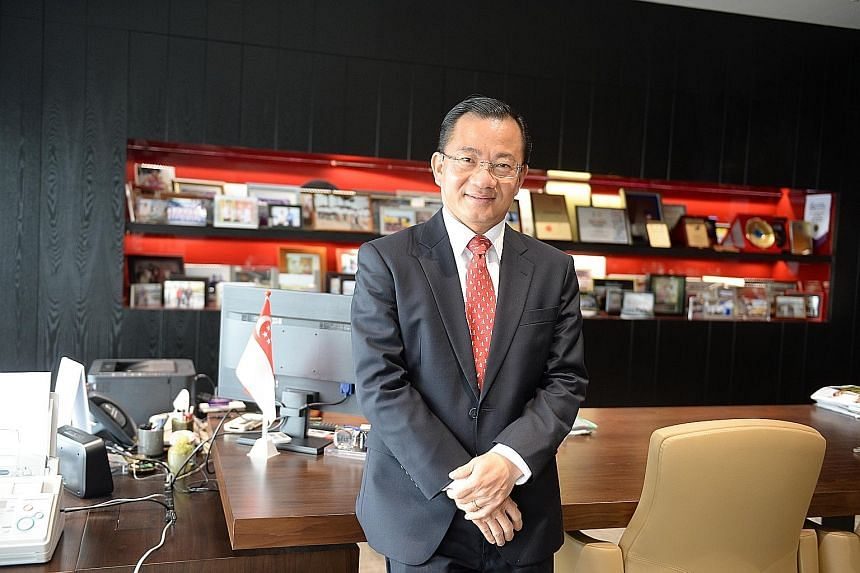 CEO Seah Kian Peng made the decision for FairPrice to stop selling suspected haze culprit Asia Pulp and Paper's products, including its existing stock, which would have cushioned the supermarket chain's losses.