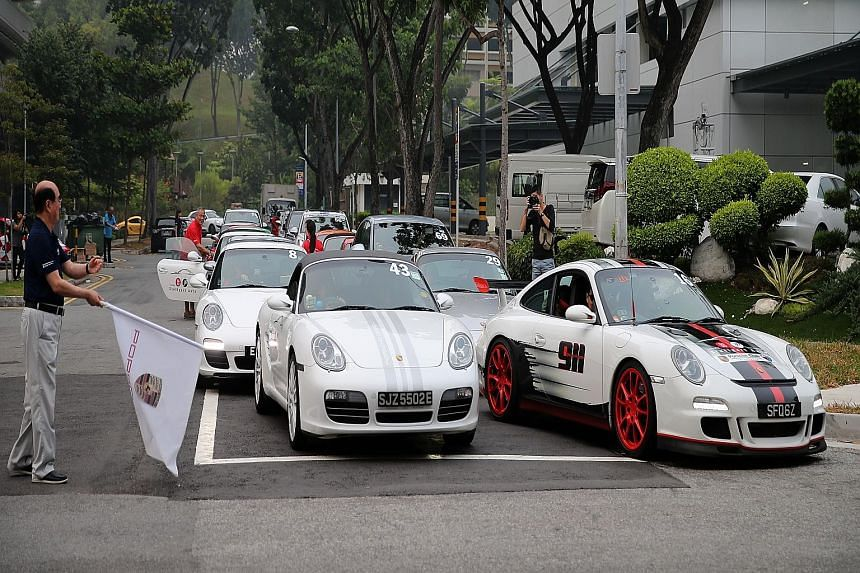 Eurokars Group executive chairman Karsono Kwee flagging off the Porsche convoy yesterday. Sixty-six Porsches took part in the fund-raising activity.