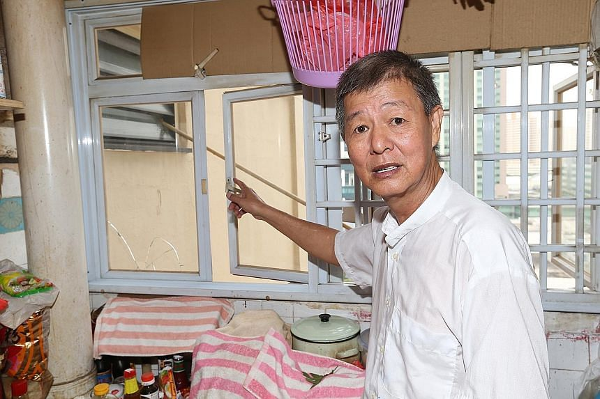 Retiree Yeo Boon Kwee has had his windows broken by his neighbours' falling bamboo poles twice. Others who live in the same HDB block as Mr Yeo also reported that poles could be dislodged by strong winds.