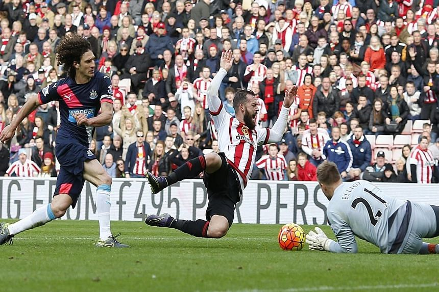 Sunderland's Steven Fletcher (right) being blocked in the penalty box by Fabricio Coloccini - resulting in a penalty and the Newcastle defender being sent off. The referee's decision appeared rather harsh.