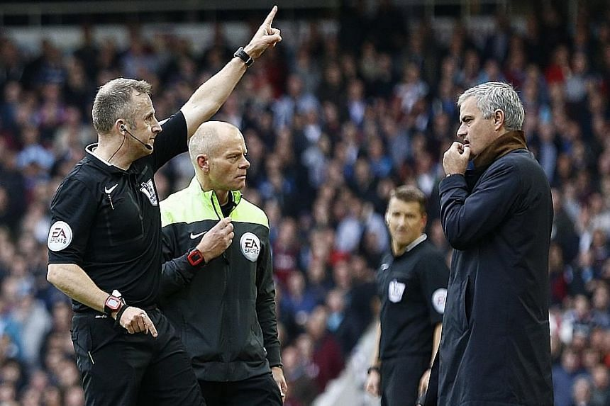 Jose Mourinho looking shocked as referee Jonathan Moss sends goalkeeping coach Christophe Lollichon and assistant first-team coach Silvino Louro (neither in the picture) to the stands. The Chelsea manager subsequently joined them for the second half
