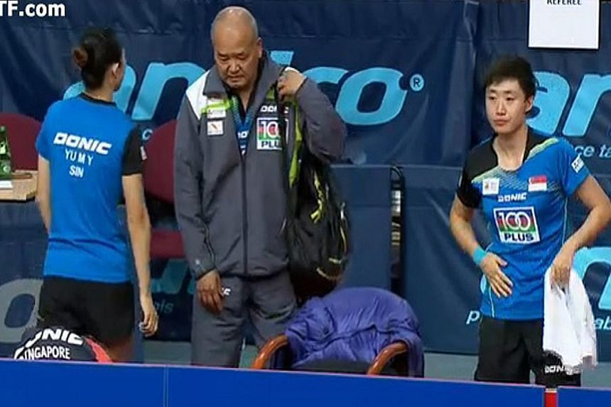 From left: Yu Mengyu, coach Hao Anlin and Feng Tianwei at the Polish Open women's doubles final yesterday, a day after the issue surfaced.
