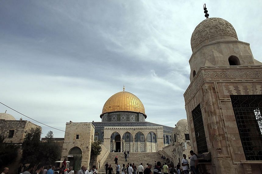 The Dome of the Rock at the Al-Aqsa mosque compound before Friday prayers last week. The compound in Israeli-annexed east Jerusalem, which is sacred to both Muslims and Jews, has been the focal point of near-daily unrest since Oct 1.
