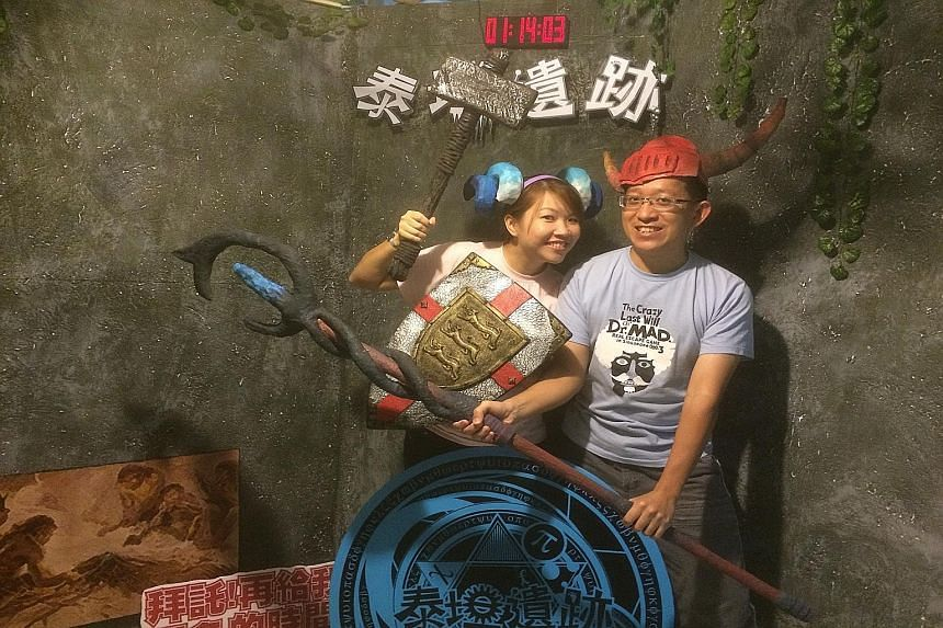Mr Alvin Koh and his wife Lynn Wong are both keen players, even travelling abroad to check out escape rooms in Taipei and other cities.