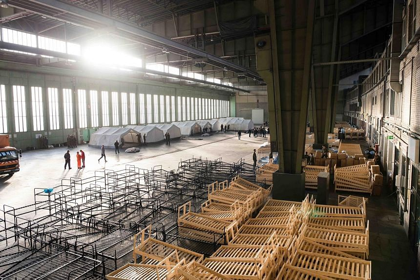 Members of the German army preparing beds and tents for refugees inside a hanger of the former Tempelhof airport in Berlin on Saturday.