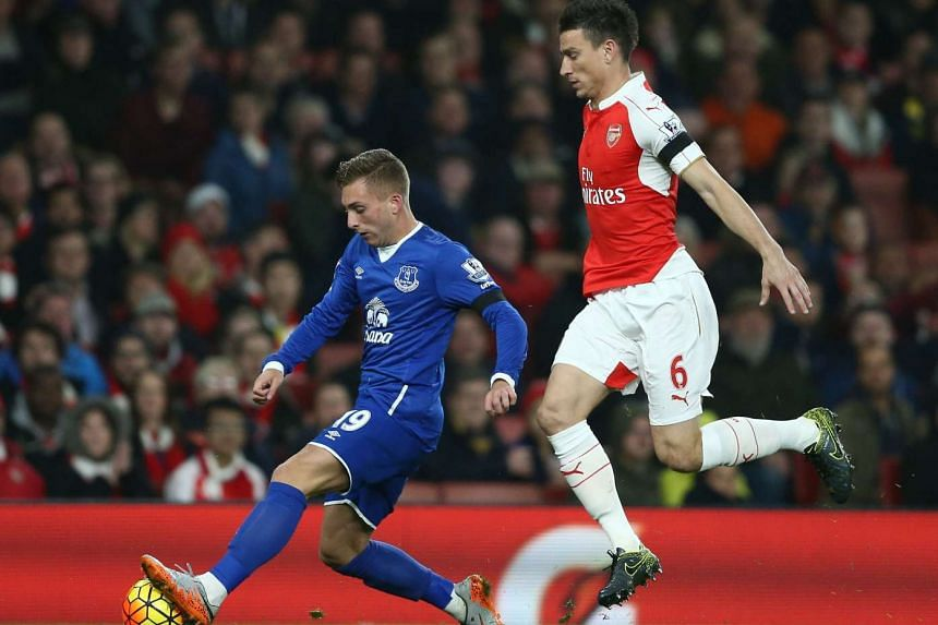 Everton's Spanish midfielder Gerard Deulofeu (left) vies with Arsenal's defender Laurent Koscielny during the match between Arsenal and Everton at the Emirates Stadium in London on Oct 24, 2015.