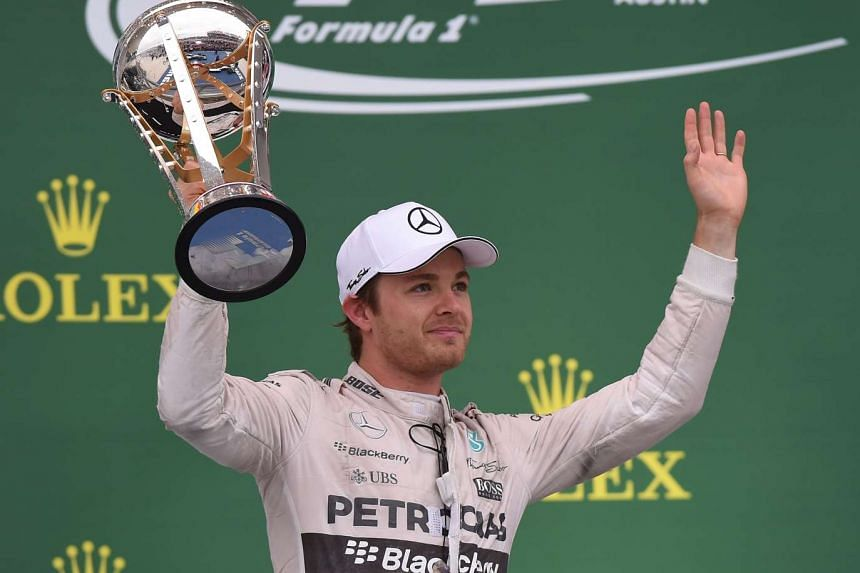 Mercedes AMG Petronas driver Nico Rosberg of Germany with his trophy after finishing in second place during the United States Formula One Grand Prix and the Drivers Championships at the Circuit of The Americas in Austin, Texas on Oct 25, 2015.