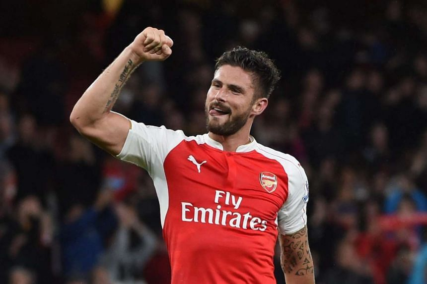 Arsenal forward Olivier Giroud celebrating after the final whistle of the English Premier League soccer match against Everton at the Emirates Stadium in London on Oct 24, 2015.
