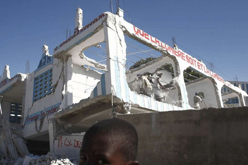 A damaged building stands two weeks after an earthquake struck the Caribbean island of Haiti, with recovery efforts hampered by a lack of a functioning government or central authority.