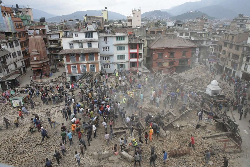People search for survivors under the rubble of collapsed buuildings in Kathmandu Durbar Square, Nepal, on April 25, 2015.