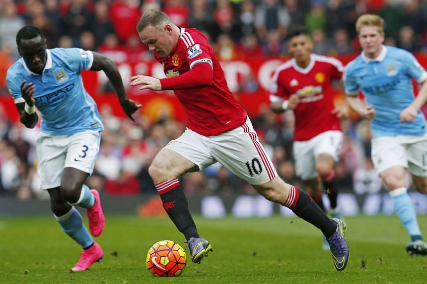 Manchester United's Wayne Rooney dribbling the ball against Manchester City during their English Premier League match at Old Trafford on Oct 25, 2015.