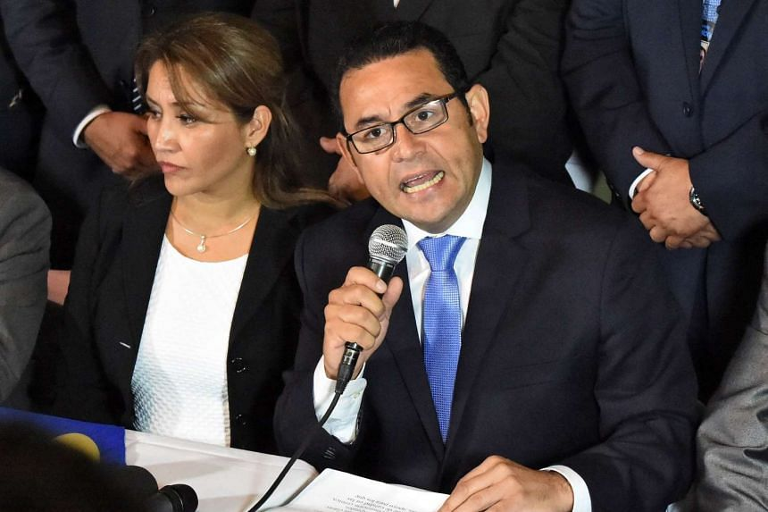 President-elect Jimmy Morales (right), of the National Front Convergence, delivers a speech next to his wife Hilda Marroquin.