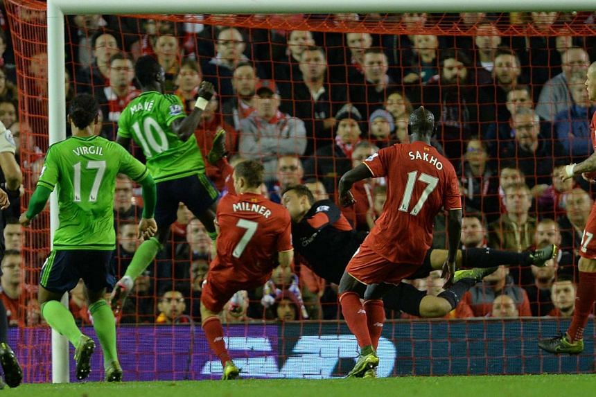 Southampton's Sadio Mane (centre) scores the equalising goal during the EPL match against Liverpool at Anfield on Sunday.