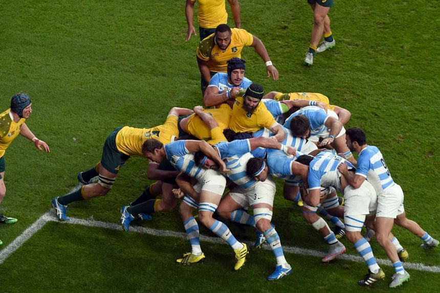 Australia's Scott Fardy (centre) in action during the Rugby World Cup 2015 semi final match between Argentina and Australia at the Twickenham Stadium in London on Sunday.