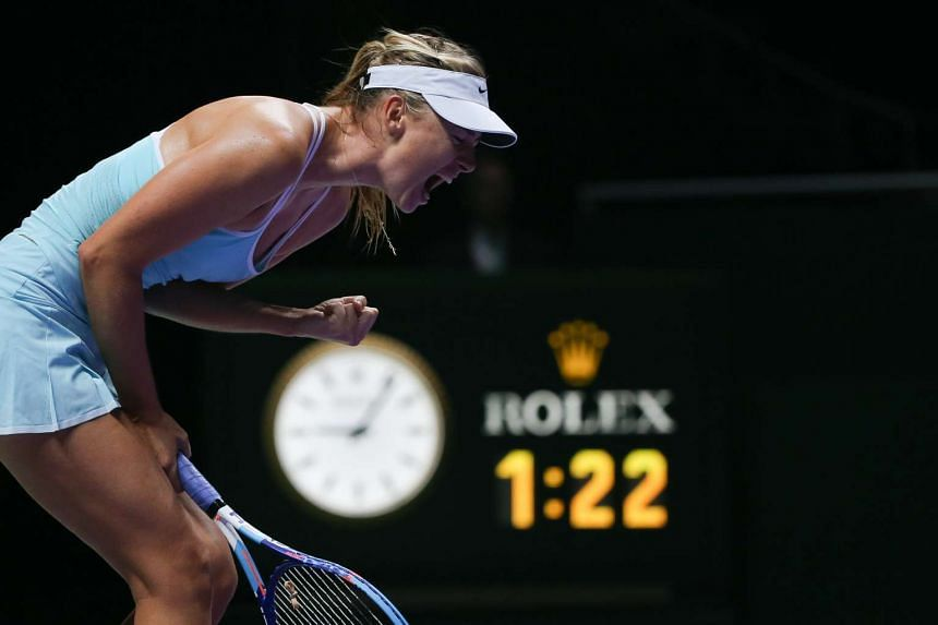 Maria Sharapova during her 4-6, 6-3, 6-4 victory over Agnieszka Radwanska in their WTA Finals Red Group encounter last night.