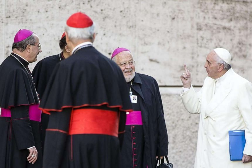 Pope Francis (right) arriving for a Saturday session of the three-week bishops' assembly at the Vatican City. The meeting, which ended yesterday, saw participants deeply divided on the extent to which the Church's teachings on issues like marriag