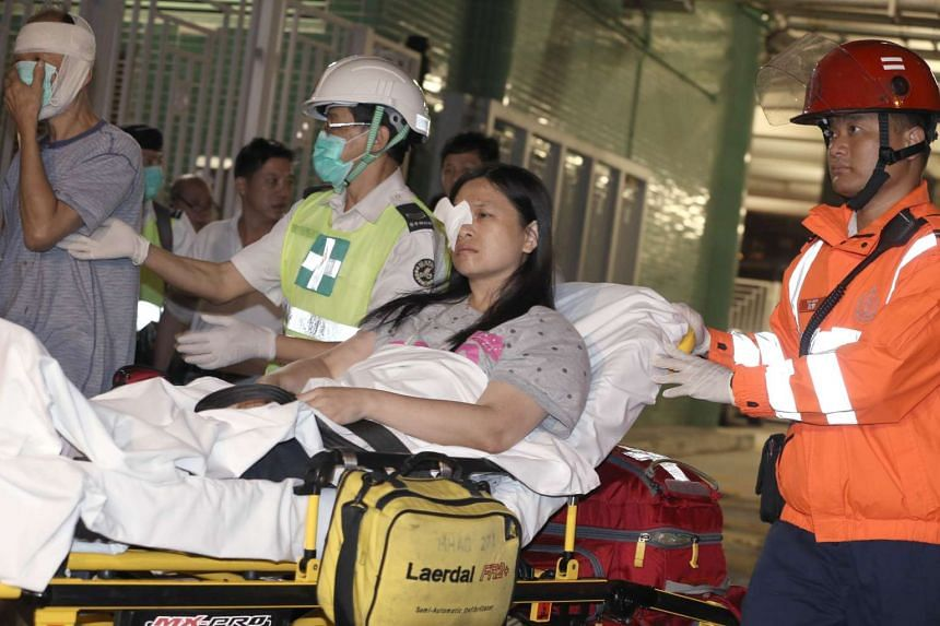 Rescue crews escorting casualties in the Hong Kong ferry accident last night. Local media reported that out of the over 100 people injured, six sustained serious injuries.