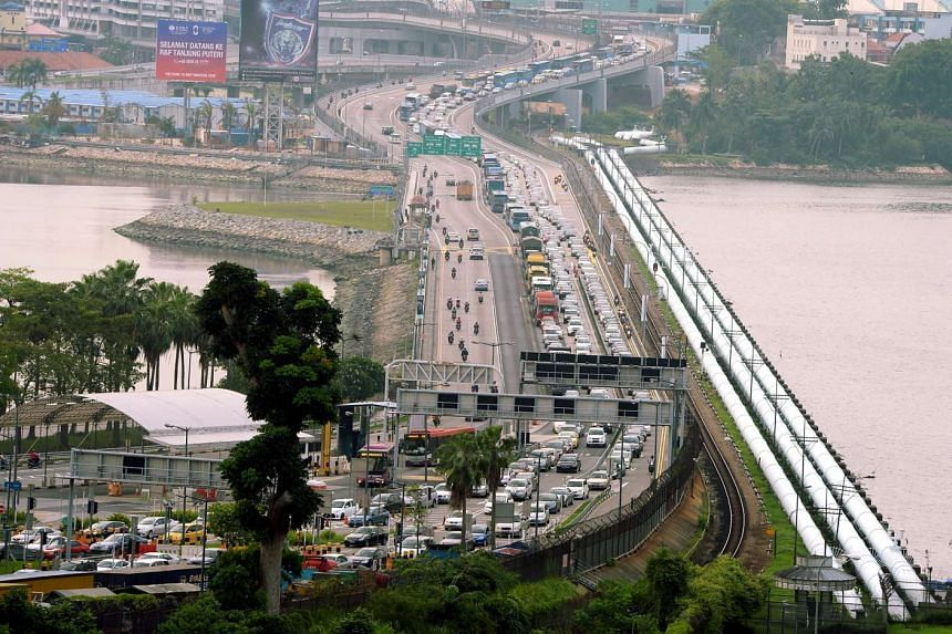 The heavy flow of traffic seen at Woodlands Checkpoints towards Johor Baru on 10 June 2014.