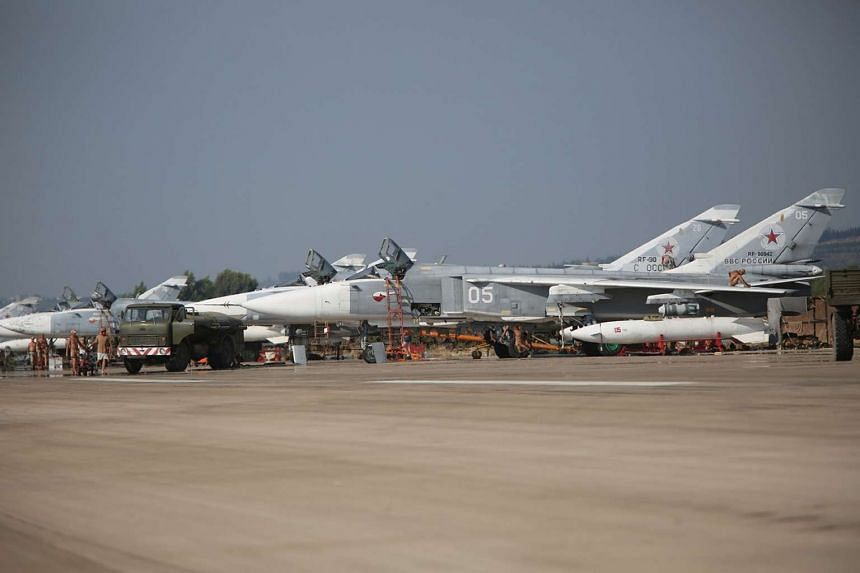 Russian Sukhoi SU-24 bombers standing on an airfield at the Hmeimim airbase in the Syrian province of Latakia on Oct 3, 2015.