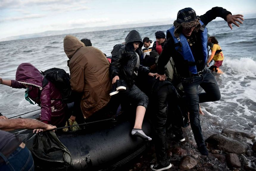 Refugees and migrants arrive on the Greek island of Lesbos after crossing the Aegean Sea from Turkey, on Oct 25, 2015.