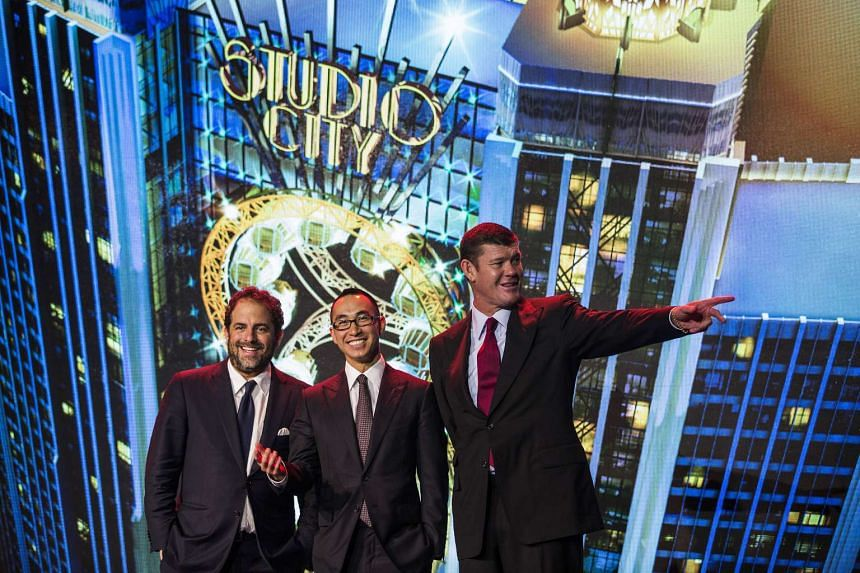 (From left) Filmmaker Brett Ratner, billionaire Lawrence Ho, and billionaire James Packer, during a news conference at Melco's Studio City casino resort in Macau, China, on Tuesday, Oct. 27, 2015.